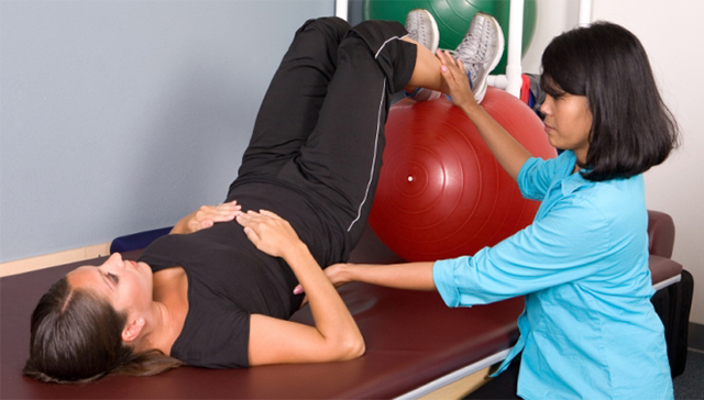 client and patient in rehabilitation with an exercise ball
